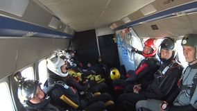 Group of skydivers sits inside a small plane awaiting a jump. Mayskoe, Dnepr, Oktober 14, 2018: Group of skydivers sits inside a small plane awaiting a jump stock video