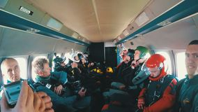 Group of skydivers sits inside a small plane awaiting a jump. MAYSKOE, DNEPR, OKTOBER 14, 2018: Group of skydivers sits inside a small plane awaiting a jump stock video footage