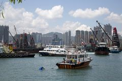 Group skyscrapers and boats in pier Hongkong royalty free stock photo