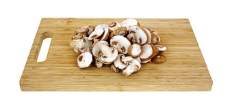 Sliced Baby Bella Mushrooms Cutting Board Stock Image