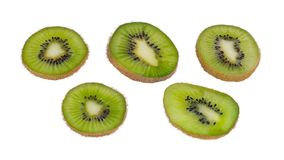 Green kiwi fruit slices. Fuzzy kiwifruit. Actinidia deliciosa. Isolated on white background royalty free stock image