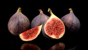 Group sliced figs  on black background Stock Photo