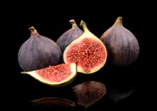 Group sliced figs  on black background Royalty Free Stock Image