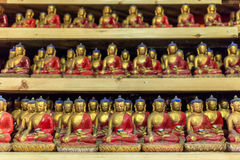 The group of small buddha statues in buddhists temple Royalty Free Stock Photos