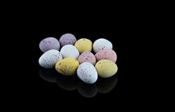Small Easter Eggs on Black Stock Images
