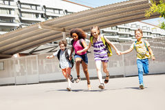 Group of small kids run near school together Royalty Free Stock Photography