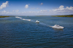 A group of small motor boats in the sea Stock Photos