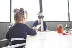 A group of small office employees check the 3d glasses royalty free stock image