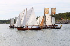 Group of small, old sailing ships rowing rapidly Royalty Free Stock Photography