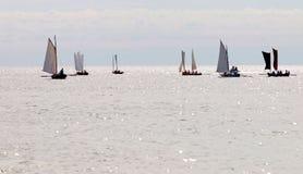 Group of small, old sailing ships towards the horizon Royalty Free Stock Photo