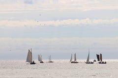 Group of small, old sailing ships towards the horizon Royalty Free Stock Photography