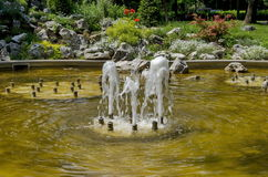Group from small water fountains flowing in front beauty rockery Stock Photo