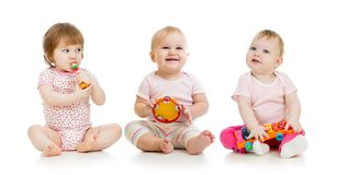 Group of babies with musical toys royalty free stock photo