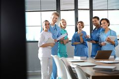 Group of medical students with gadgets in college. Group of smart medical students with gadgets in college royalty free stock photo