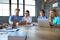 Group of smart medical students with gadgets royalty free stock image