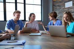Group of smart medical students with gadgets royalty free stock photo