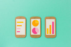 Group of smartphones with different charts and reports Stock Photos