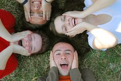 Group smile. Young people lying on grass Royalty Free Stock Photography