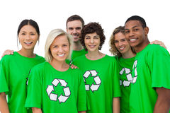 Group of smiling activists wearing green shirt with recycling sy Stock Images