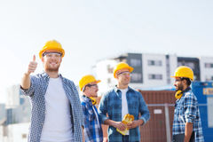 Group of smiling builders in hardhats outdoors Royalty Free Stock Photography
