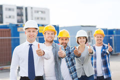 Group of smiling builders in hardhats outdoors Royalty Free Stock Photo