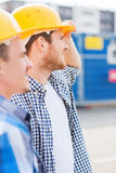 Group of smiling builders in hardhats outdoors Royalty Free Stock Photos