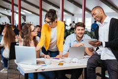Group of smiling business people working together in office stock images