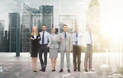Group of smiling businessmen making handshake Stock Image