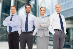 Group of smiling businessmen outdoors Stock Photos
