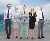 Group of smiling businessmen over city background Stock Images