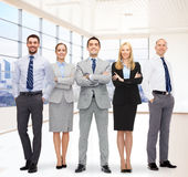 Group of smiling businessmen over office room Stock Image