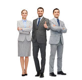 Group of smiling businessmen showing thumbs up Royalty Free Stock Images
