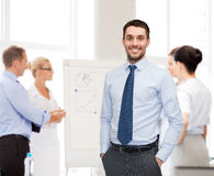 Group of smiling businessmen with smartboard Royalty Free Stock Image