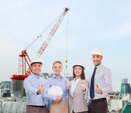 Group of smiling businessmen in white helmets Royalty Free Stock Photo