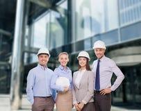 Group of smiling businessmen in white helmets Stock Photos