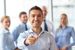 Group of smiling businesspeople meeting in office Royalty Free Stock Photography