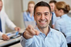 Group of smiling businesspeople meeting in office Stock Image
