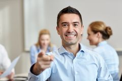 Group of smiling businesspeople meeting in office Stock Photos