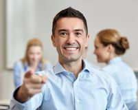 Group of smiling businesspeople meeting in office Stock Images