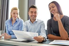 Group of smiling businesspeople meeting in office Stock Photo