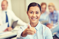 Group of smiling businesspeople meeting in office Royalty Free Stock Images