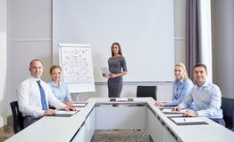 Group of smiling businesspeople meeting in office Royalty Free Stock Image