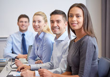 Group of smiling businesspeople meeting in office Royalty Free Stock Photos