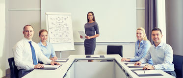 Group of smiling businesspeople meeting in office Stock Photography