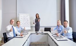 Group of smiling businesspeople showing thumbs up Stock Photography