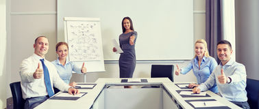 Group of smiling businesspeople showing thumbs up Stock Images