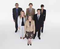 Group Of Smiling Businesspeople In Triangle Formation Stock Photos