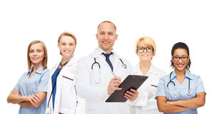 Group of smiling doctors with clipboard Stock Photos
