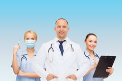 Group of smiling doctors with clipboard Stock Images