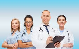 Group of smiling doctors with clipboard Royalty Free Stock Image